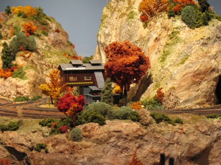 Model railroad coaling station and mountains